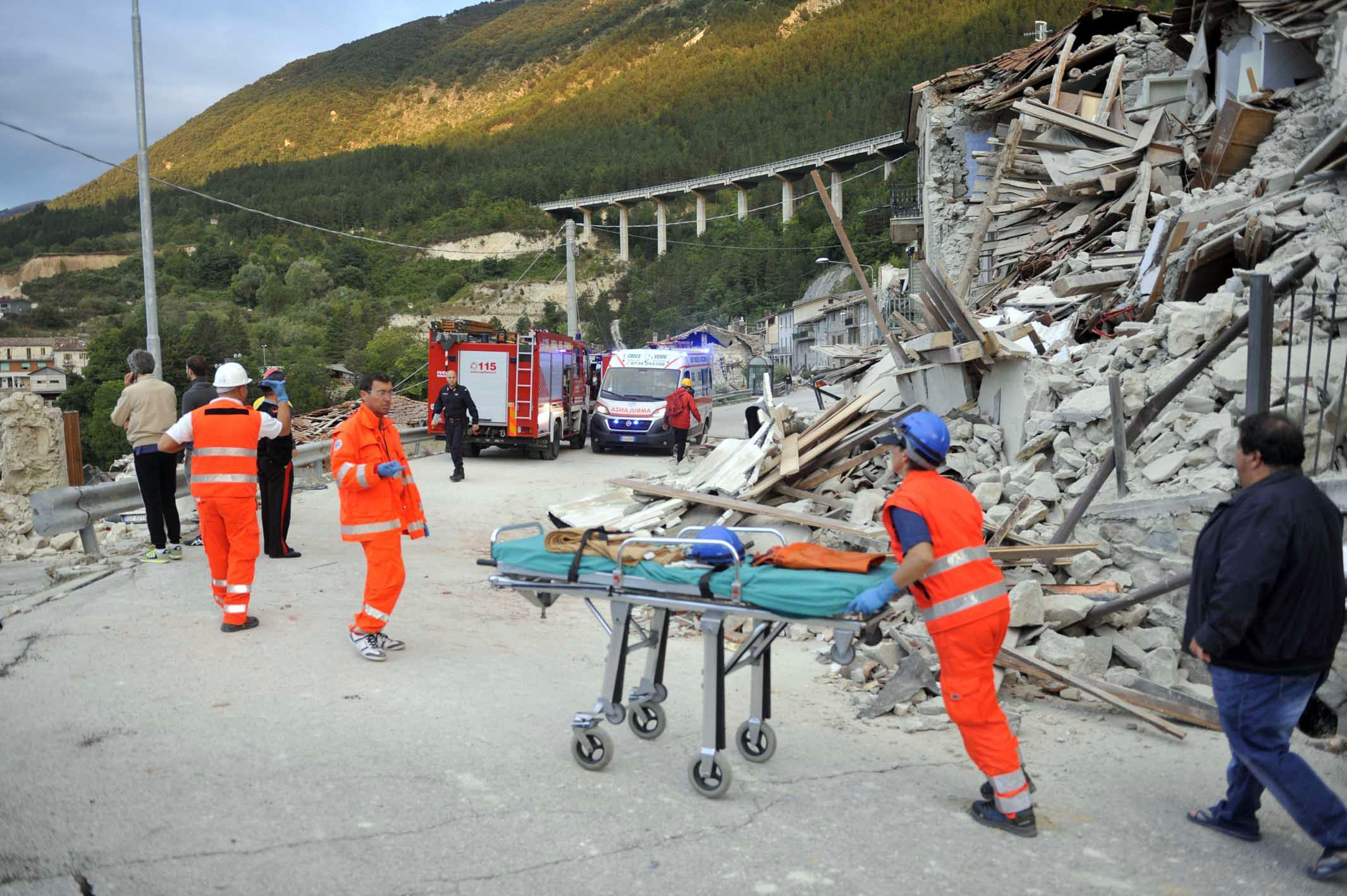 The rescuers in Pescara del Tronto, near Arquata del Tronto, Ascoli Piceno, in Marche Region, 24 August 2016. A 6.1 earthquake struck just after 3:30 a.m.. The quake was felt across a broad section of central Italy, including the capital Rome where people in homes in the historic center felt a long swaying followed by aftershocks. ANSA/ CRISTIANO CHIODI